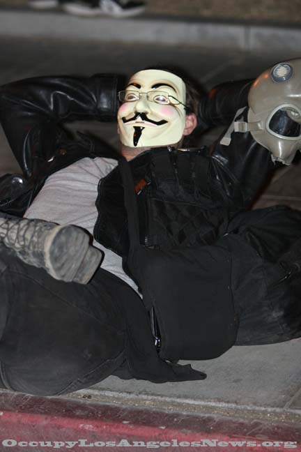 Anonymous member of Occupy LA on the night LAPD raided the encampment in 2011. Photo by Mitch for OccupyLosAngelesNews.org