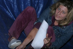 While at OLA in 2011, Melissa Balin is seen here showing the marks on her arm she said were inflicted by police during one of her arrests.