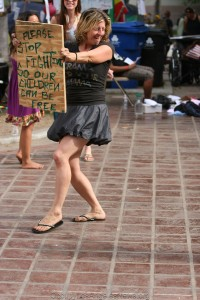 """Melissa Baling with sign """"Stop fighting so our children can be free."""" Balin claims Los Angeles and police actions resulted in the """"miscarriage of her first pregnancy."""""""