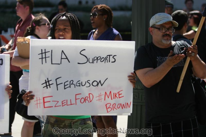 "Ferguson Misssouri police officers wear wrist bands of support for cop, Darren Wilson, who killed black teenager Michael Brown. ""I am Darren Wilson."""
